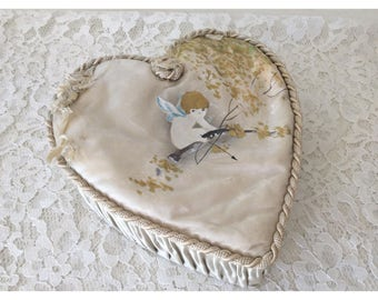 Super adorable vintage heart shaped satin ruched covered box with hand painted cherub and tattered ribbons on top