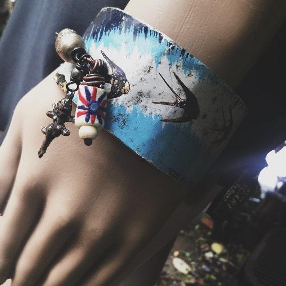 Rustic vintage tin bracelet cuff | swallow cuff, rustic assemblage, Cherub milagros, rustic cuff, tin cuff, printed tin