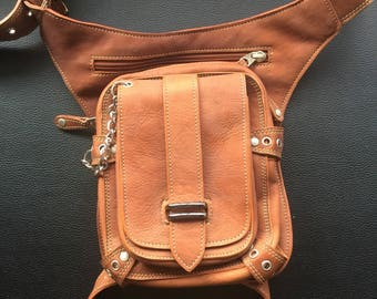 Tan leather utility belt with attachable leg strap