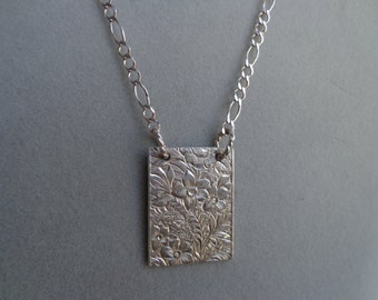 Silver .925 rectangle pendant with silver chain.