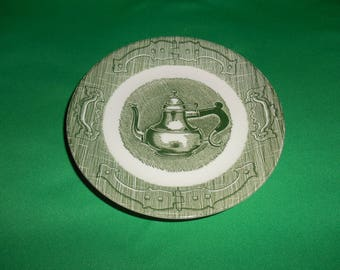 """One (1), 6 1/8"""" Saucer, from Royal (USA), in; The Old Curiosity Shop Green Pattern."""