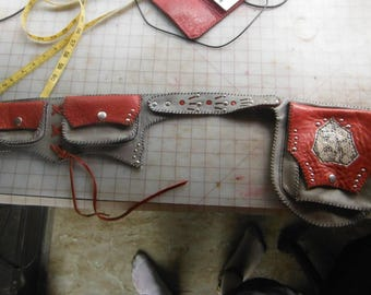 grey and red leather pocket belt