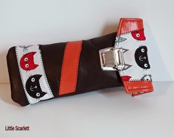 spectacle cases in orange and brown leather and fabrics cat
