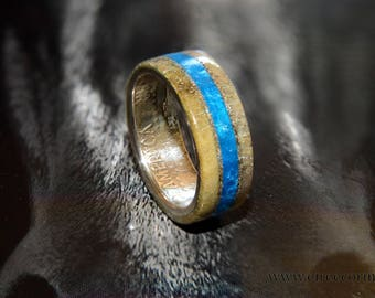 Silver half dollar coin ring with deer antler and turquoise inlay