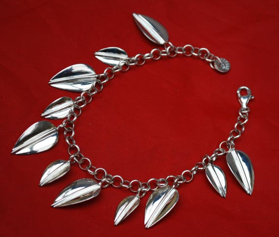 Sterling Leaf bracelet -Signed RLM Studio - Robert Lee Morris -  - silver leaves Charm cha cha bracelet