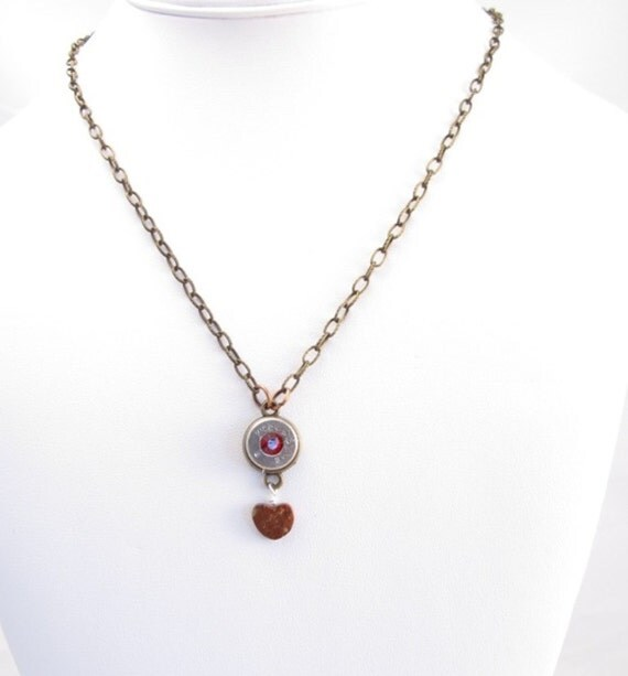 Necklace  9mm plus p silver bullet casing with red crystal and brecciated jasper heart dangle on brass chain with brass toggle closure
