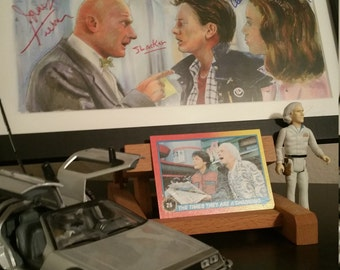 """Double Autograph Back to the Future - You're a Slacker McFly  Framed Print Signed by """"Mr.Strickland and Jennifer Parker"""""""