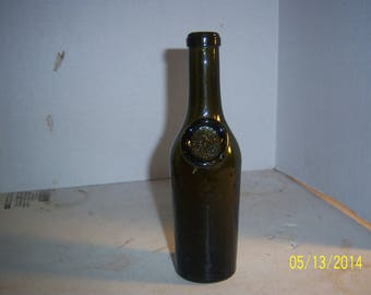 1890's J.M. Oliver & Sons 7 1/8 inch olive green sealed wine or olive oil bottle
