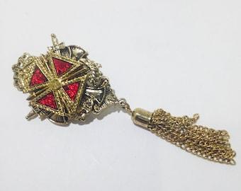 Vintage crest tassel brooch