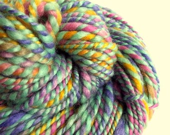 Handspun kniting yarn, pink chunky wool, blue faced leicester yarn, thick bulky yarn, purple, yellow, pink and mint greens