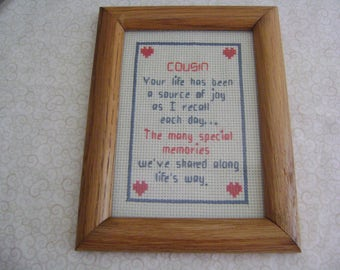 handmade cross stitch cousin picture framed