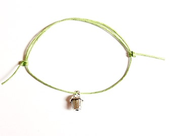 silver cupcake charm on waxed cotton cord adjustable friendship bracelet