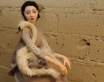 Art doll the ballerina Anna Pavlova and a swan.