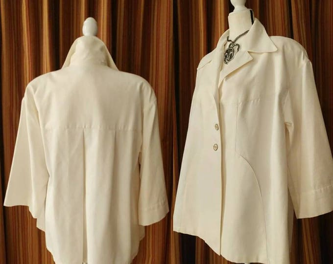 Featured listing image: Vintage Karl Lagerfeld Two-Tone Textured Cotton Swing Jacket with Quarter Moon Shaped Pockets and Shoulder Pads Made in France LARGE