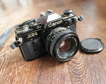 1980s Perfectly-Working Black Vintage Canon Ae-1 Analog Camera Retro Single-lens reflex