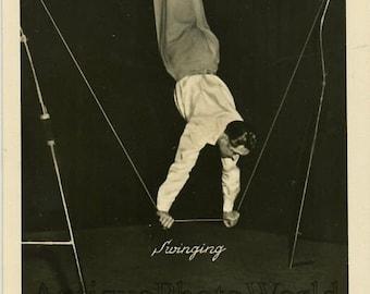 Circus acrobat balancing on bar vintage photo