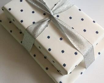 Cute and classy luxe holiday gift wrap   mini trees   mini menorahs   mini jewish stars   hanukkah and christmas gift wrap