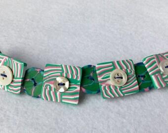Pistachio and raspberry button bracelet.