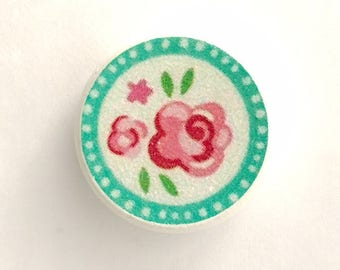 Drawer pull with pretty rose pattern