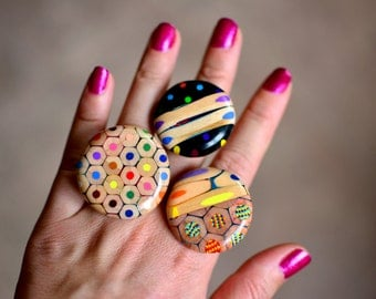 Ring  made of magic jumbo and classic colored pencils.