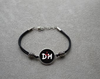 """Wristband leather """"DM"""" consisting of a leather link and a silver metal connector"""
