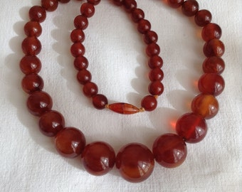 1940's amber coloured bakelite necklace.