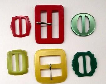 Six Vintege Catalin / Bakelite Belt Buckles. Tutti Frutti Colours
