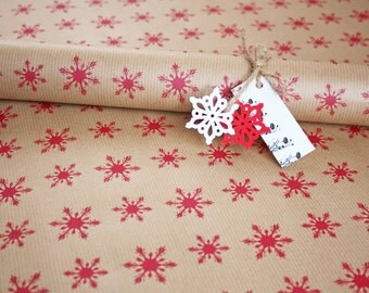 Christmas gift wrap, hand printed wrapping paper sheet, red snowflakes on brown Kraft paper