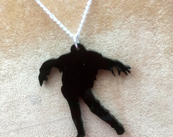 "walking dead inspired necklace..black ""ZOMBIE"" silhouette"