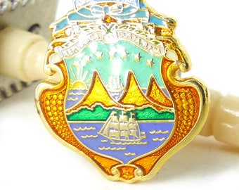 Beautiful enamel lapel pin.  America Central Republic Of Costa Rica collector pin. Sailing scene with mountains