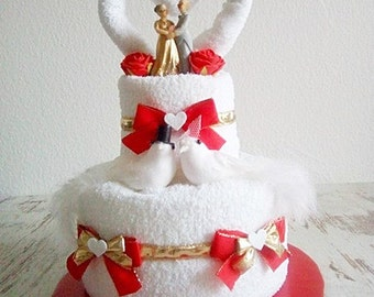 Wedding cake from towels golden wedding cake gift to the golden wedding red white bride and groom get married