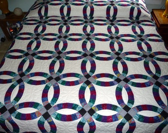 Amish Double Wedding Ring Quilt - Handmade entirely of batik print fabrics