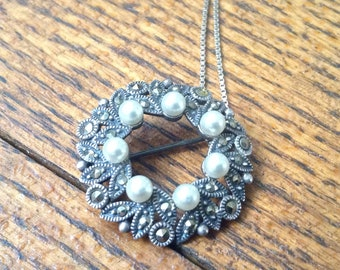 Sterling, pearl ans Marcasite pin on a chain.