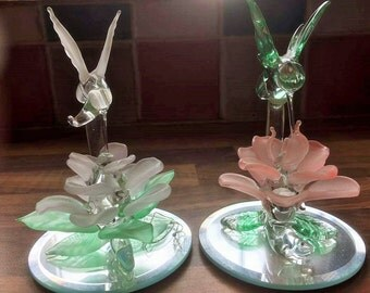 Set of two blown glass hummingbirds with glass flower on mirror stands