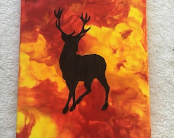 8 X 10 melted red and yellow crayon art & decoupage canvas featuring a stag patronus silhouette inspired by Gryffindor and Harry Potter