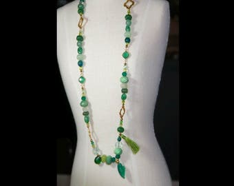 Multi green gem stones and goldplate necklace.