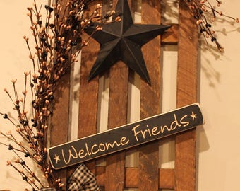 "Decorated Tobacco Lath Fence with Star, Berries and Wooden ""Welcome Friends"" Sign"