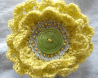 The lime-green knitted flower brooch