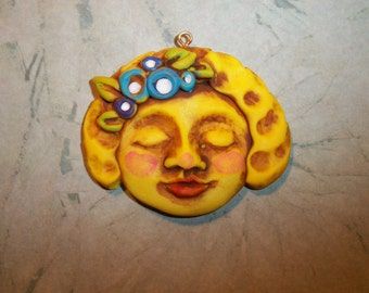 Goddess,Girl Face Pendant,Charm,43mm wide by 36mm tall,handmade supply,YELLOW,sweet face,blue,purple flowers,focal bead,polymer,cabochon