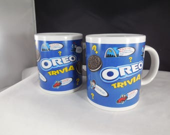 Oreo Trivia coffee mugs in blue and white, a pair of matching coffee mugs.