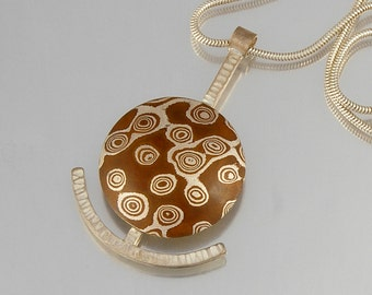 Mokume Gane Pendant - Dots on domed disc with abstract anchor in sterling silver and copper