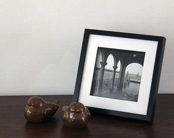 original photo of boats on the harbour framed in black box frame
