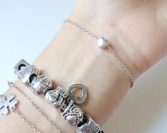 Bracelet with tiny heart gold and silver