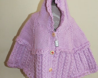UNIQUE hand-knitted hooded poncho in pale lilac to fit 3-6 months