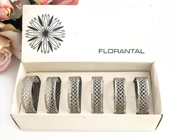 6 silver plated napkin rings in box, Florantal brand, England, open lattice pattern, pretty and delicate looking, circa 1970s