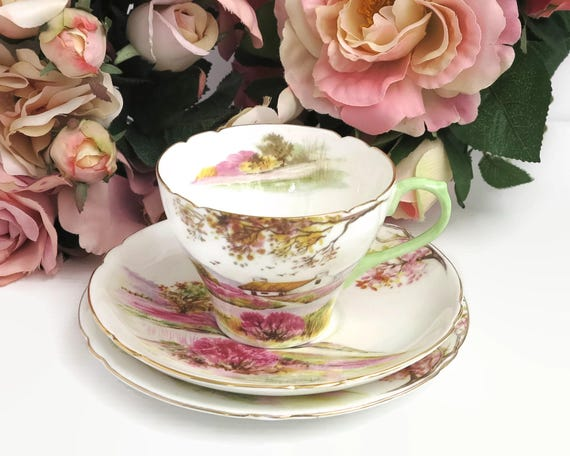Vintage Shelley Old Ireland cup, saucer, and plate, hand painted depiction of Irish countryside with pink and gilt trim, 13657, 1945 - 1966