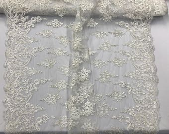 Ivory paisley flower embroider and corded with metallic silver tread-wedding-bridal-prom-nightgown-decorations. Sold by the yard.