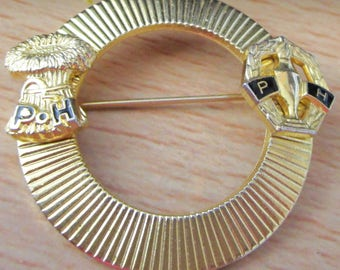 "vintage goldtone brooch/badge in new condition round 1.5""across pleated circle with PH design on either side"