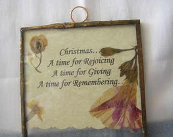 Christmas SENTIMENT glass pressed wildflowers on parchment paper.