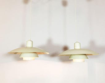 Pair of PH4 hanging lamps by Poul Henningsen.